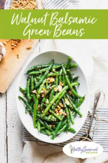 overhead of green beans with a cutting board and text overlay