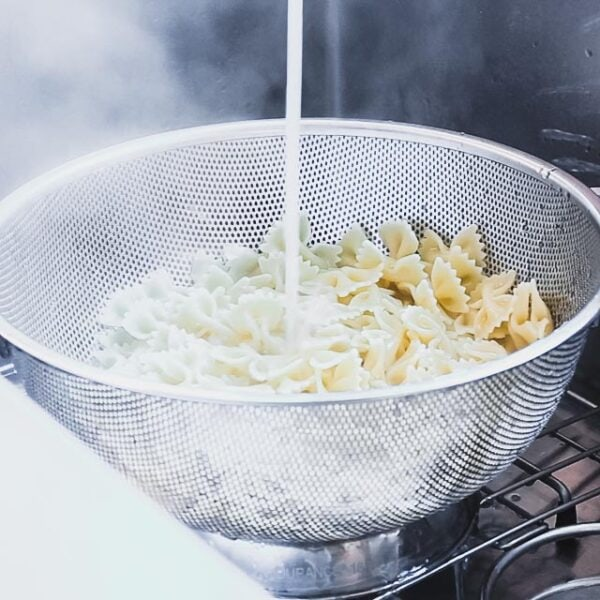 Drain the pasta and rinse with cool running water.