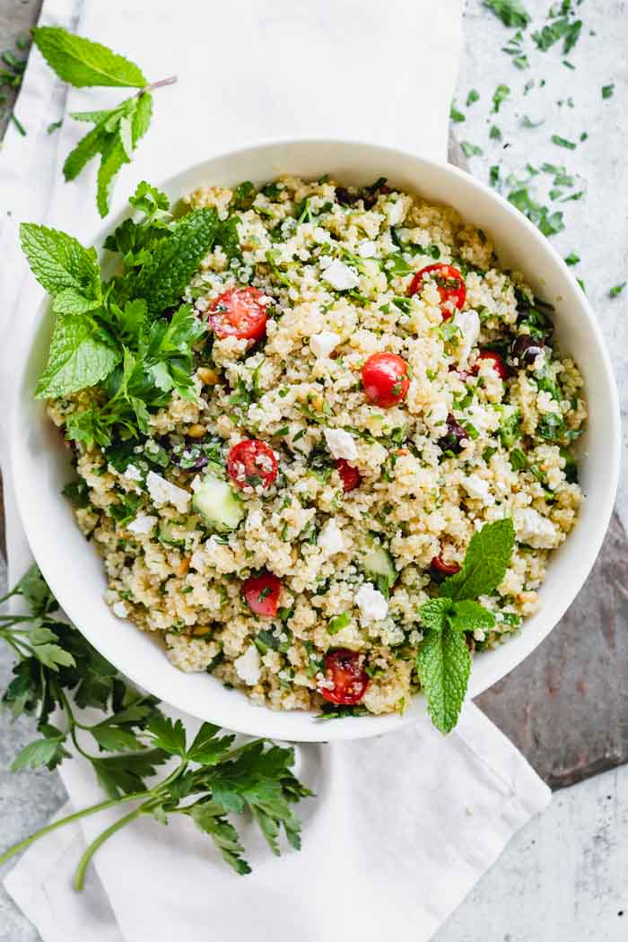 Quinoa Salad in a white bowl with a white napkin- from overhead