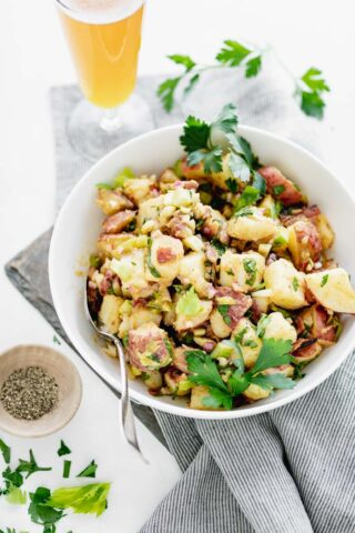 Potato Salad in a white bowl from three quarters view