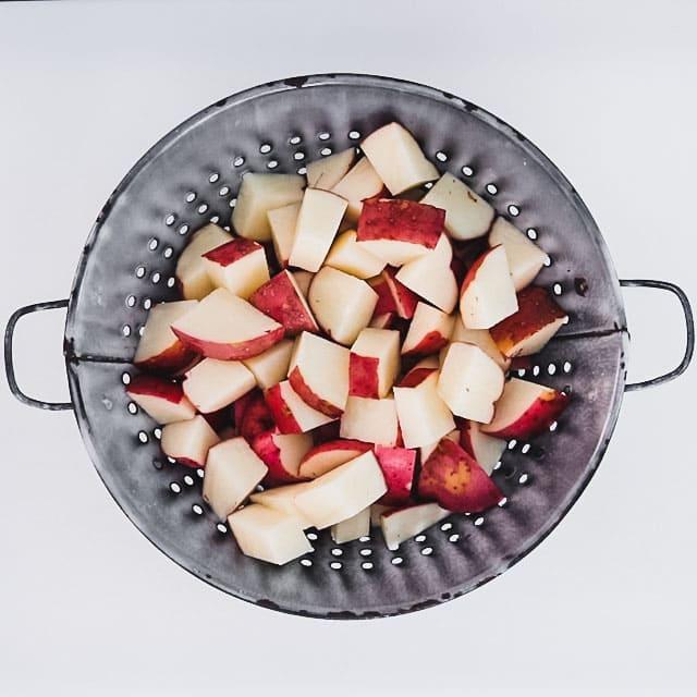 cut potatoes in a colander