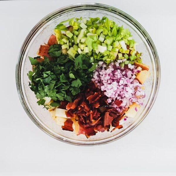 Add the bacon, parsley, celery and onion and toss to combine.