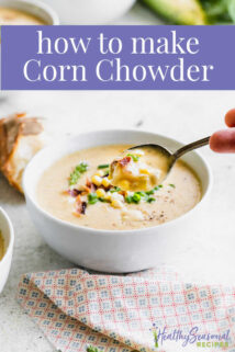 Corn chowder from the side, a spoonful held to camera with text overlay