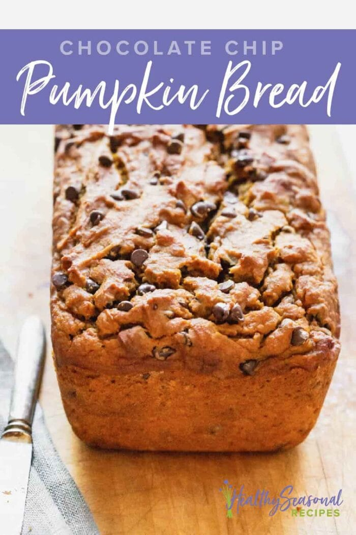a loaf of pumpkin bread with chocolate chips up close from 3/4 view with text overlay