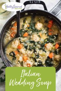 Italian wedding soup in a black pot with a ladle