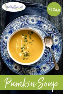 pumpkin soup in a bowl on a blue and white plate