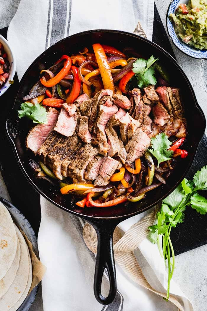 Steak fajita filling (peppers, onions and steak) in a skillet