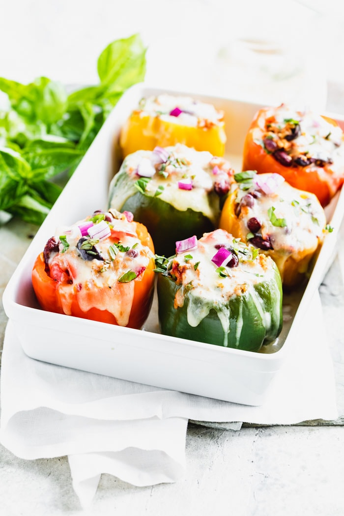 Stuffed bell peppers in a white casserole