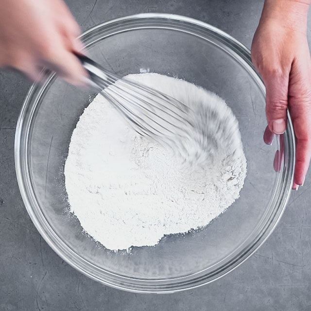 whisking dry ingredients in a bowl