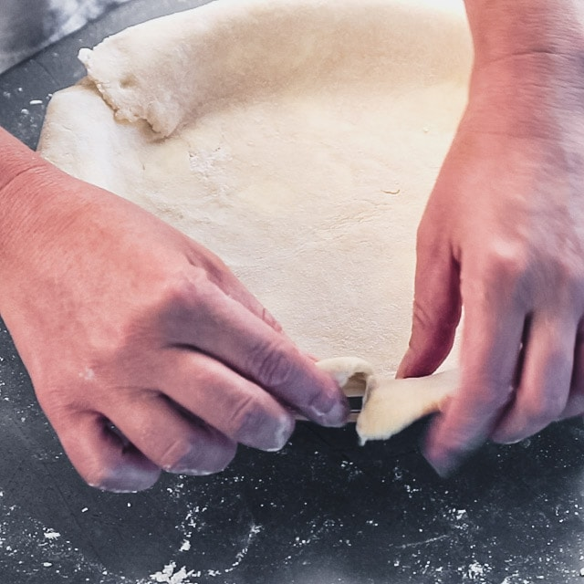 Fold under the edges of the pie dough