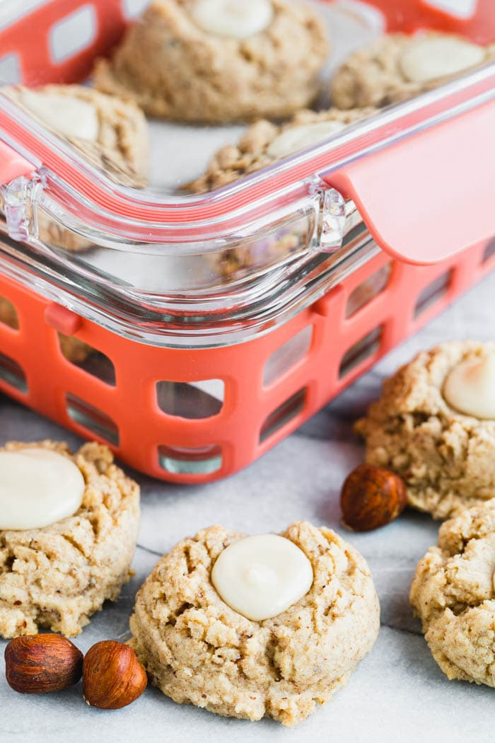 Maple Hazelnut thumbprint cookies and pink storage containers