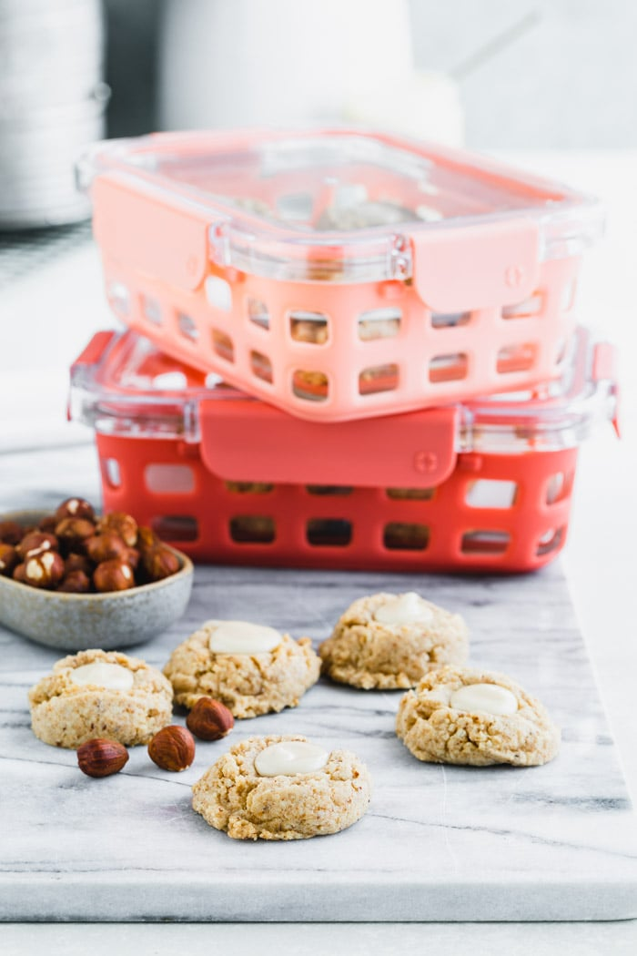 make ahead prep work on a marble board with pink containers ready to freeze