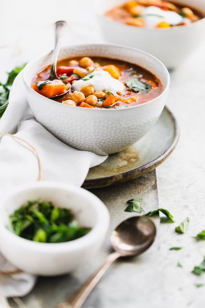 Chickpea stew from the side in a white bowl