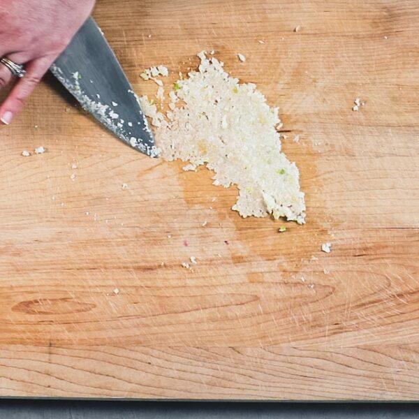making garlic paste with salt