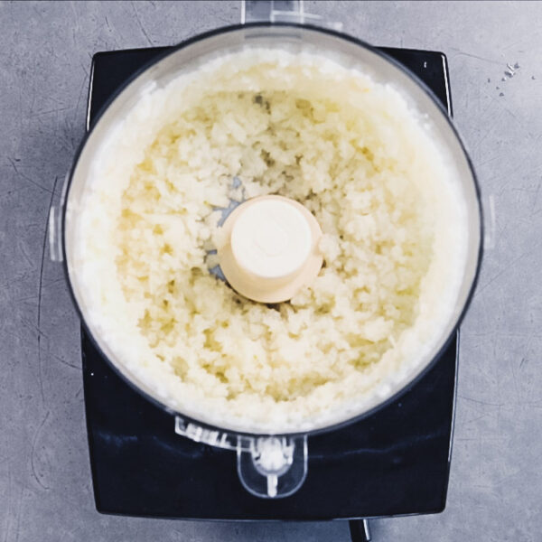 the chopped cauliflower pieces in the food processor