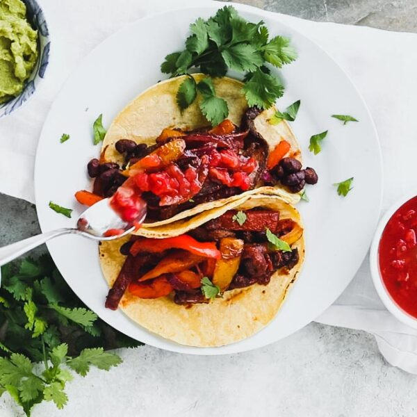 topping the tacos with salsa