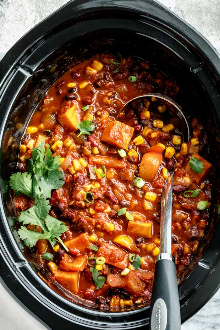 The slow cooker from above with the chili in it