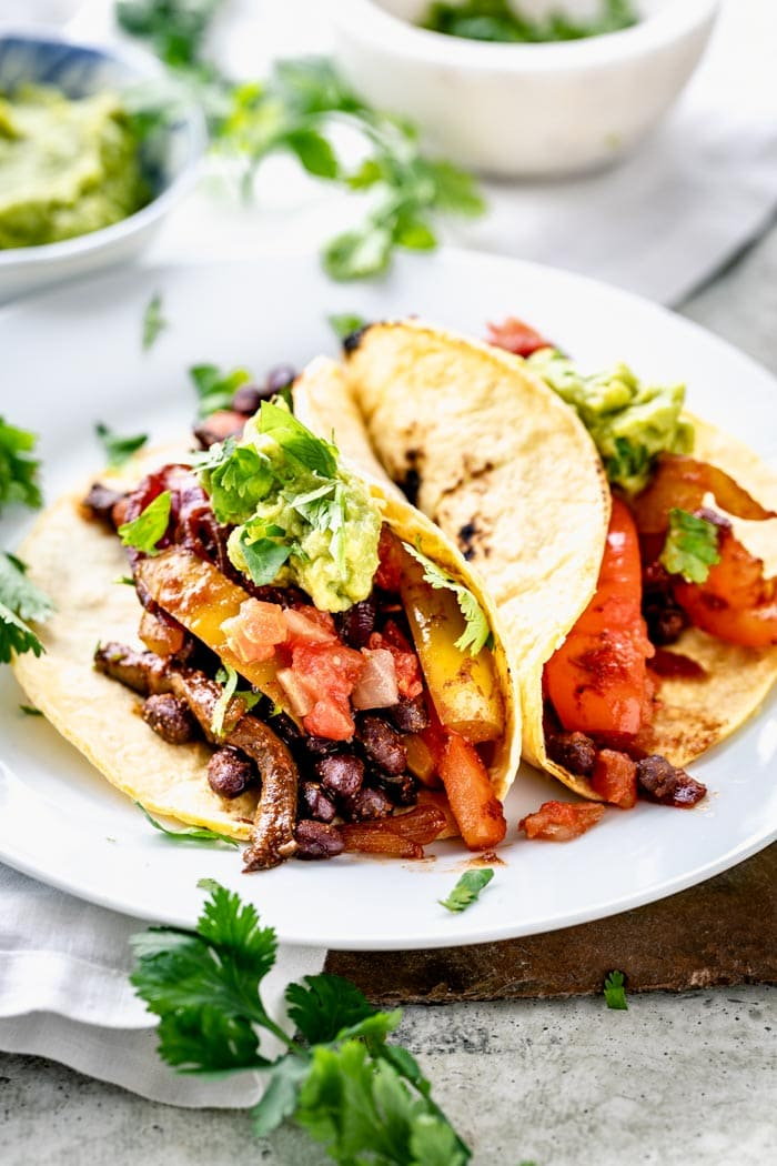 vegan tacos on a plate from the side