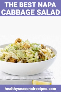Napa Caesar in a white bowl with salad tongs