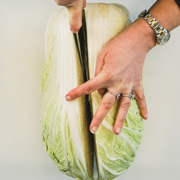 Cut the cabbage in half lengthwise.