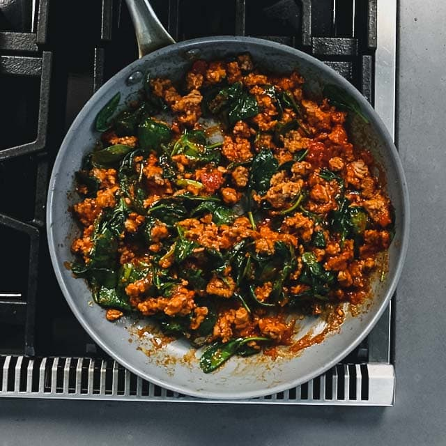 add the spinach and marinara and cook until the spinach is wilted