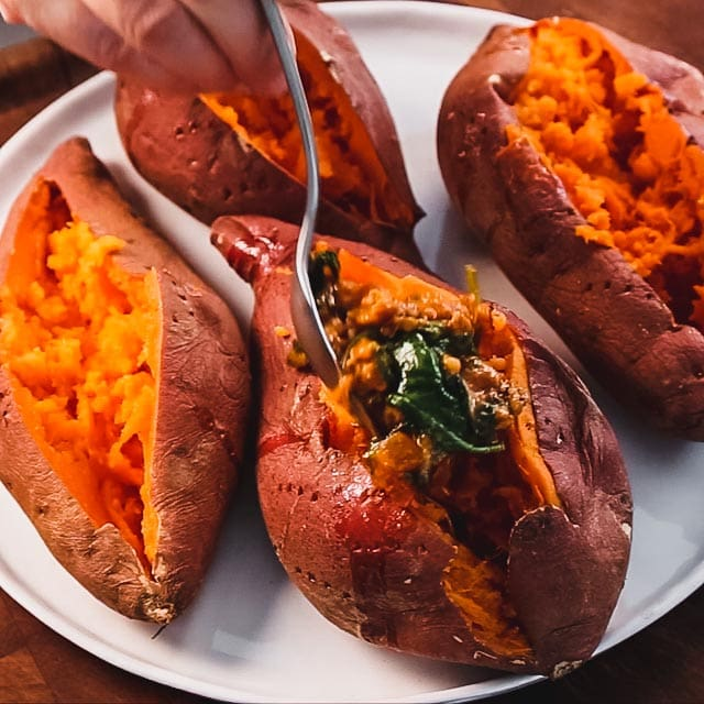 add the filling to the sweet potatoes