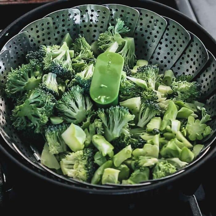 the broccoli in a steamer basket