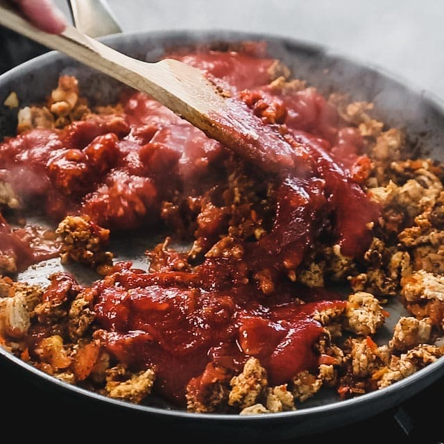 stir the canned tomato into the chicken and veggie mixture