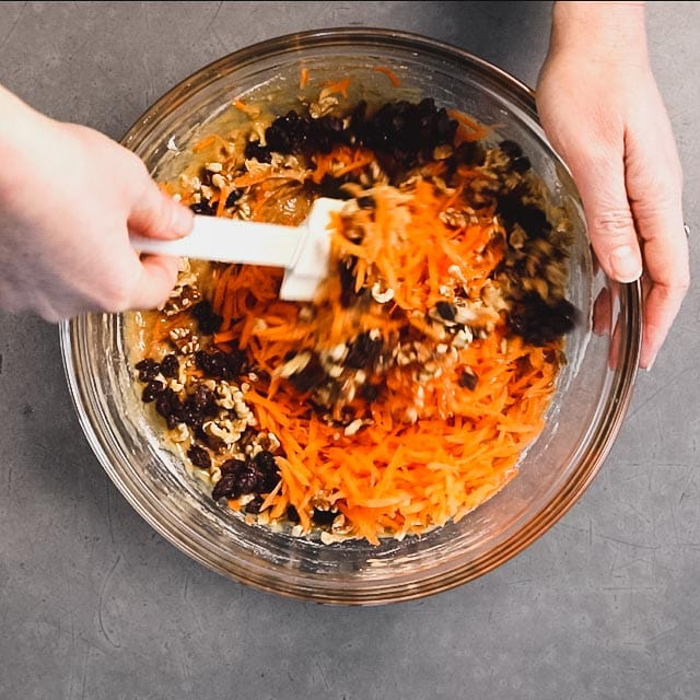 Add the shredded carrots, raisins and nuts to the batter and gently combine