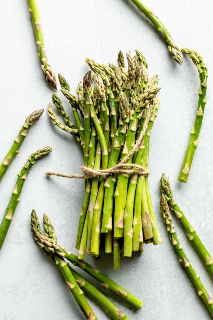 A bunch of asparagus stalks tied with twine