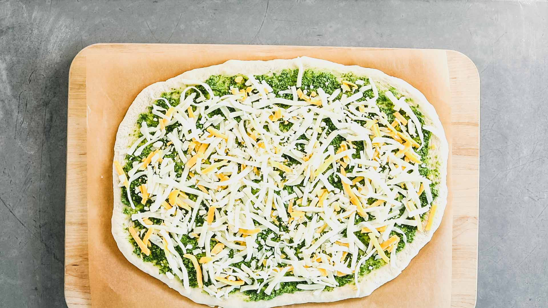 the pizza with cheese and pesto from overhead