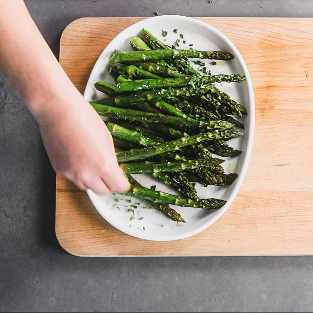 plattering the asparagus with garnishes