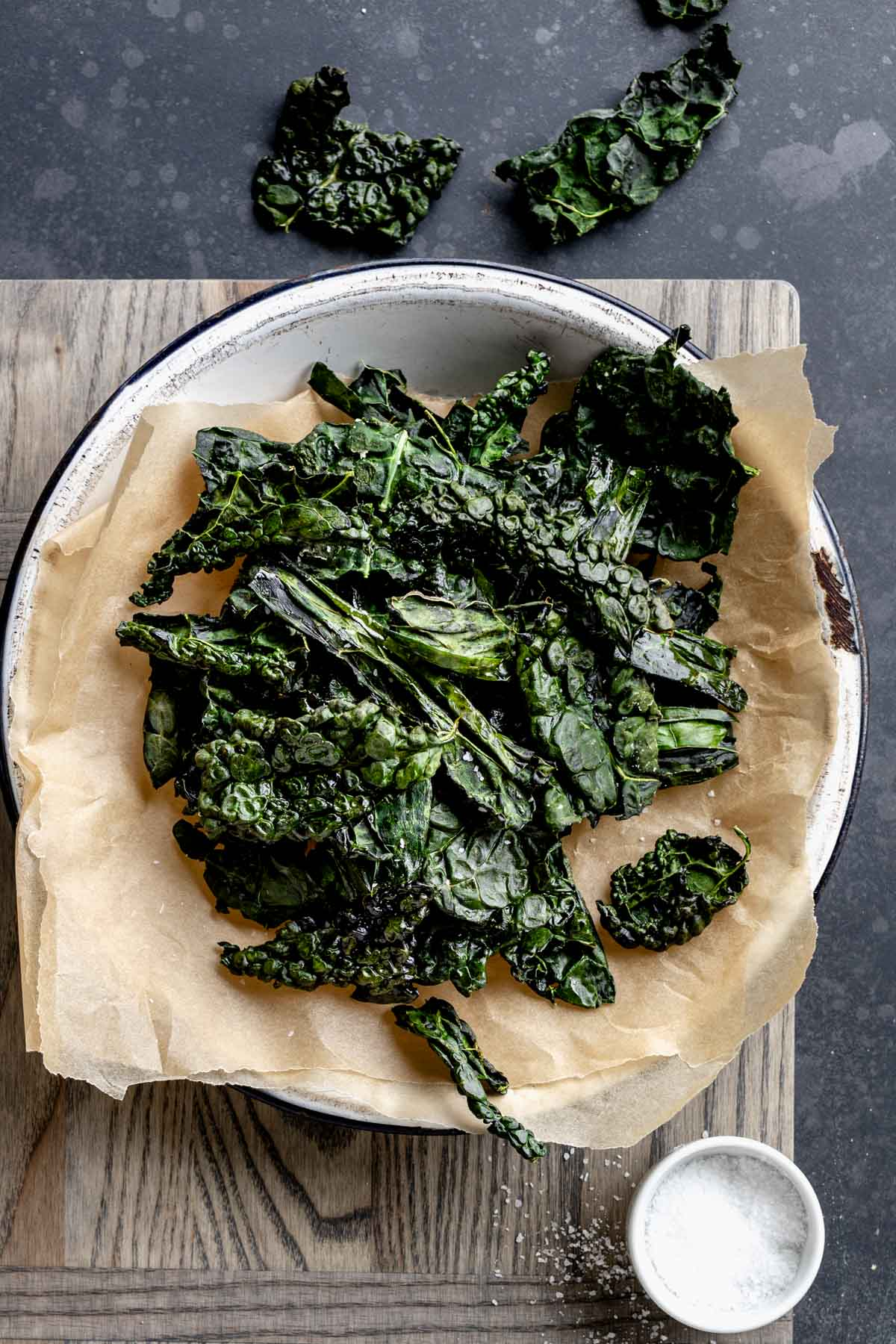 Kale Chips in a metal pie tin with parchment