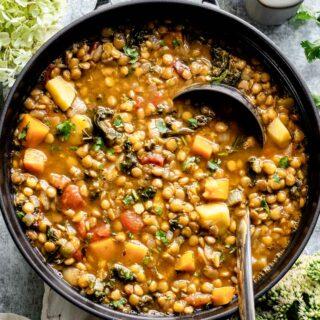 Lentil soup close up in a black pot