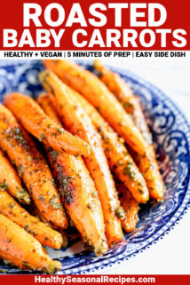 WHOLE BABY CARROTS ROASTED AND MIXED WITH PESTO IN A BLUE BOWL