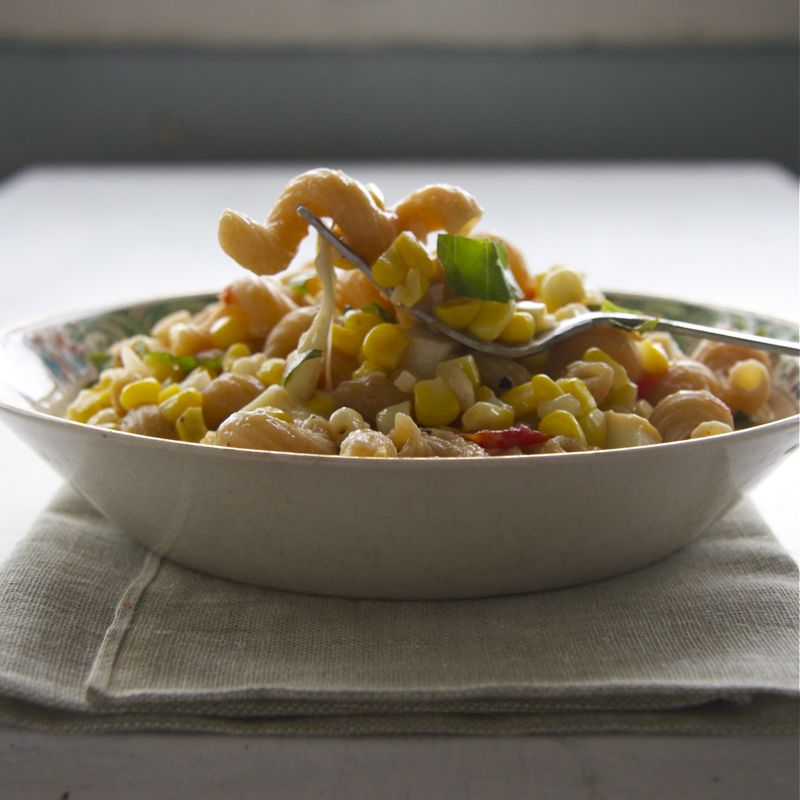 A bowl of food, with Sweet corn and Grilled corn
