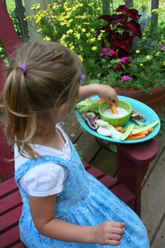 child eating vegetables with low fat ranch dip